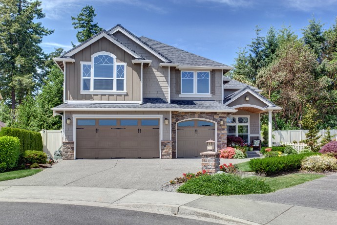 home-exterior-with-garage-and-driveway-with-nice-landscaping-desing-around